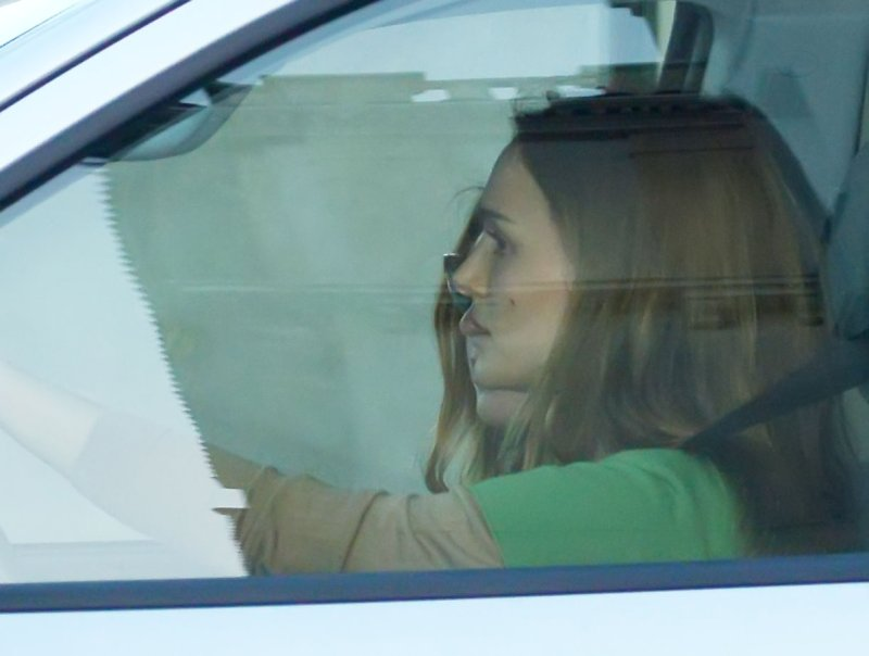 Natalie Portman in her car leaving Barneys New York 04_02_13.jpg